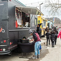 Doce Taqueria serves customer at Pittsburgh Food Truck Park