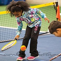 Kids enjoying paddle tennis
