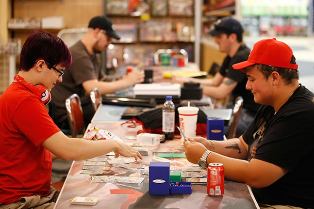 Nate Jacob (right) and Brady Eddinger (left) play Pokemon at New Dimension Comics at the Pittsburgh Mills Mall - CP PHOTO BY JARED WICKERHAM