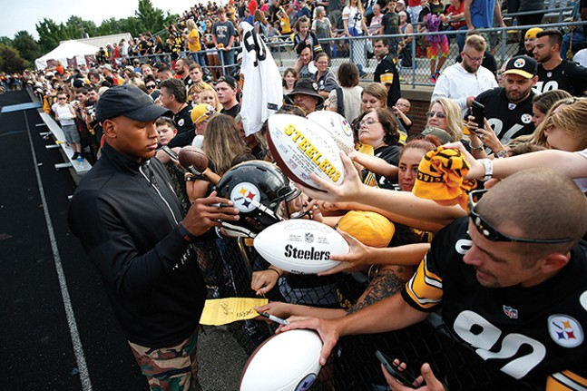 Ryan Shazier signs autographs for fans during training camp. - CP PHOTO: JARED WICKERHAM