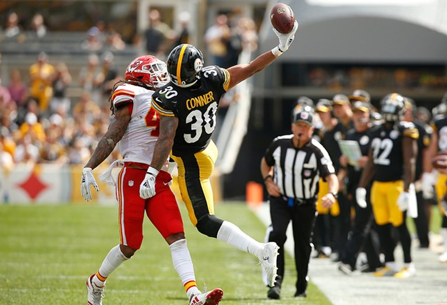 James Conner makes a catch before being pushed out of bounds. - CP PHOTO: JARED WICKERHAM
