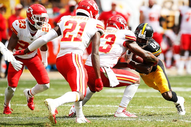 Antonio Brown tries to push his way through a row of Kansas City Chiefs tacklers. - CP PHOTO: JARED WICKERHAM