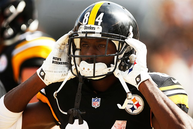 Antonio Brown puts his helmet on before entering the game against the Kansas City Chiefs. - CP PHOTO: JARED WICKERHAM