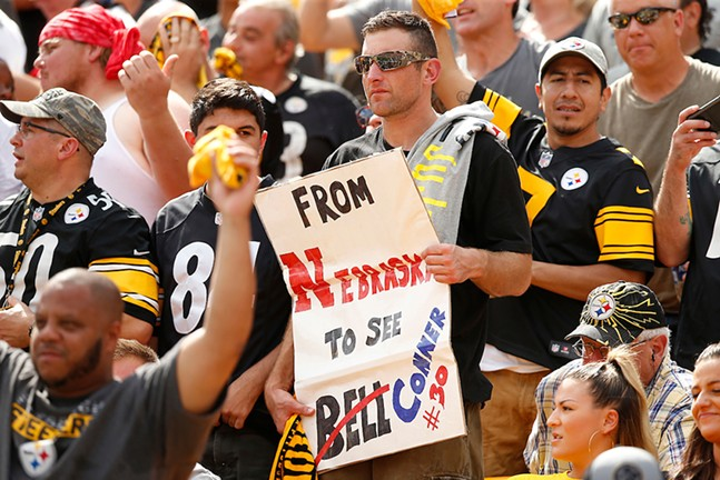 A Pittsburgh Steelers fan holds up a sign against the Kansas City Chiefs during the game at Heinz Field - CP PHOTO: JARED WICKERHAM