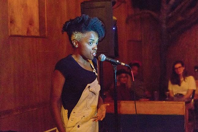Corrine Jasmin performing at an open mic night. - HEATHER KRESGE