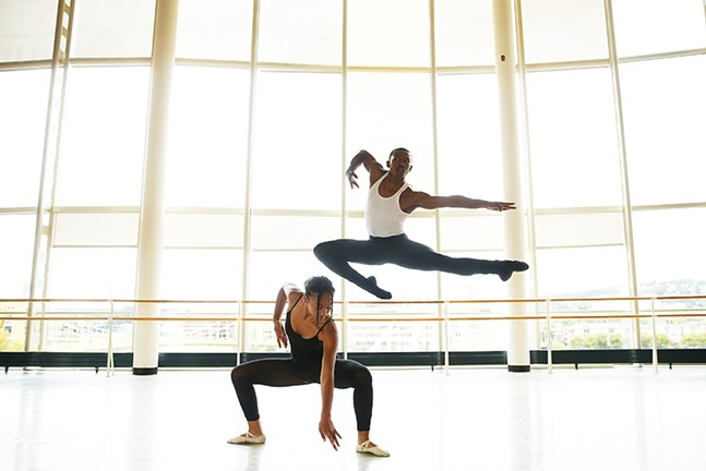 Lexis Wright, a senior at CAPA, and Jau'mair Garland, a junior, dance together with a view of the sister bridges in the background at CAPA school. - CP PHOTO: JARED WICKERHAM