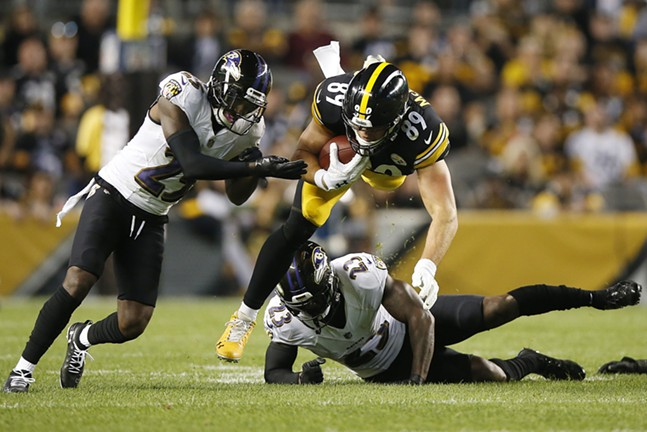 Vance McDonald is upended by Tony Jefferson. - CP PHOTO: JARED WICKERHAM