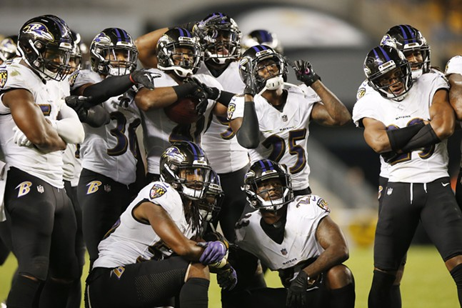 Baltimore's defense celebrates the turnover together. - CP PHOTO: JARED WICKERHAM
