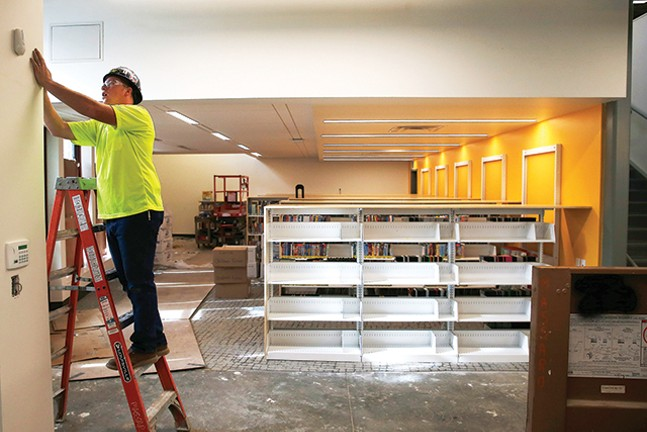 Construction takes place at the Carnegie Library in Carrick during a passive house tour on Thu., Oct. 11. - CP PHOTO: JARED WICKERHAM