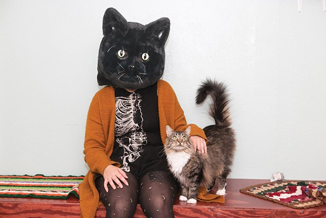 The Black Cat Market co-owner Indigo Baloch with adoptable cat Petunia - CP PHOTO: JOHN COLOMBO