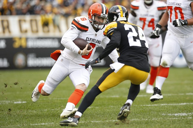 Baker Mayfield #6 of the Cleveland Browns runs with the ball past Coty Sensabaugh #24. - CP PHOTO: JARED WICKERHAM