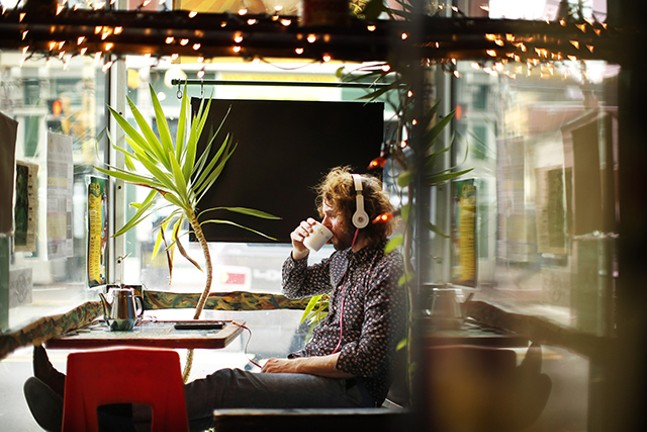 Gary Musisko of Regent Square listens to music in the window at Beehive Coffee. - CP PHOTO: JARED WICKERHAM