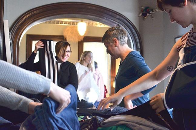 Rachel Rearick, Carin Mincemoyer, and Rachel Yonan swap clothes at Renee Piechocki's Sixth Annual Clothes Swap. - CP PHOTO: TERENEH IDIA