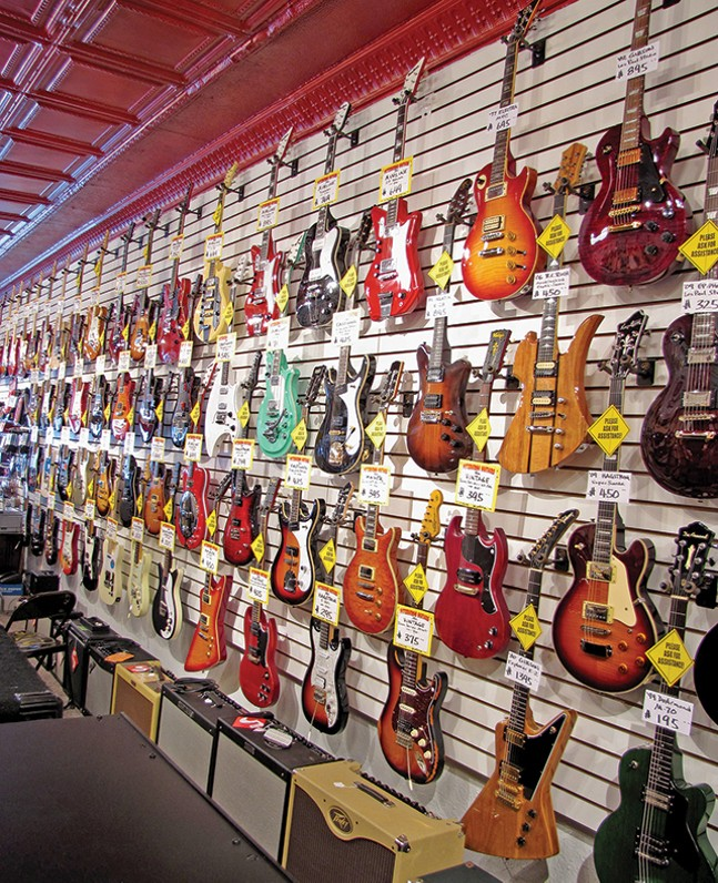Merchandise for sale inside Pittsburgh Guitars in South Side - BETSY GERSON