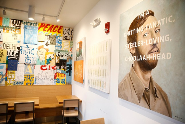 The interior of Choolaah BBQ, which features 25 different original works of art. - CP PHOTO: JARED WICKERHAM