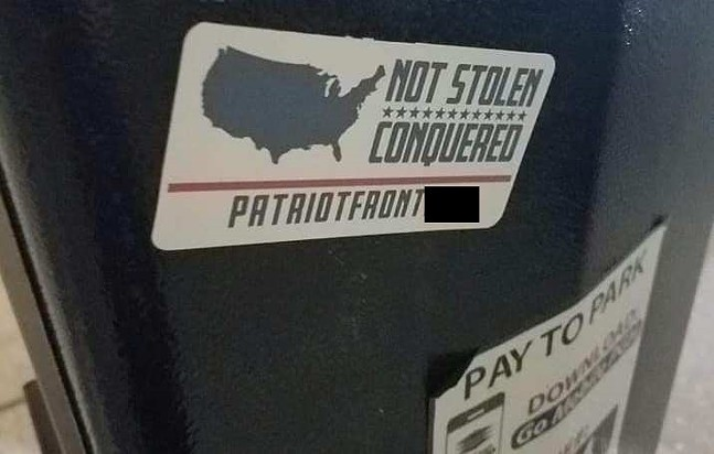 White Nationalism sticker on parking meter outside Belvederes in Lawrenceville