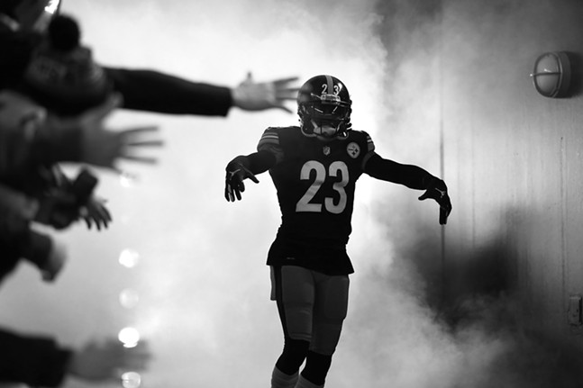 Joe Haden enters amidst smoke and fans. - CP PHOTO: JARED WICKERHAM