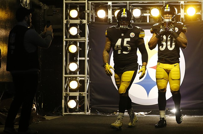 Roosevelt Nix and James Conner enter Heinz Field together. - CP PHOTO: JARED WICKERHAM