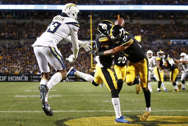 Joe Haden & Sean Davis collide to allow a touchdown catch by Keenan Allen. - CP PHOTO: JARED WICKERHAM