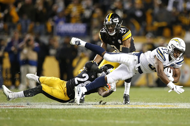 James Conner suffers a leg contusion on this play while being tackled by Adrian Phillips. - CP PHOTO: JARED WICKERHAM