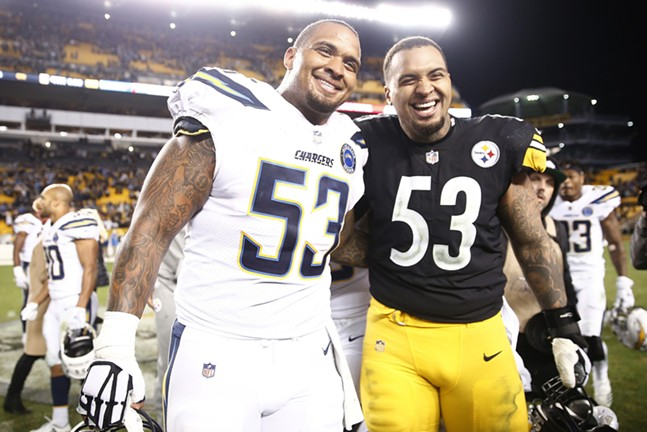 Twin brothers Mike (left) and Maurkice Pouncey (right) pose for a photo postgame. - CP PHOTO: JARED WICKERHAM