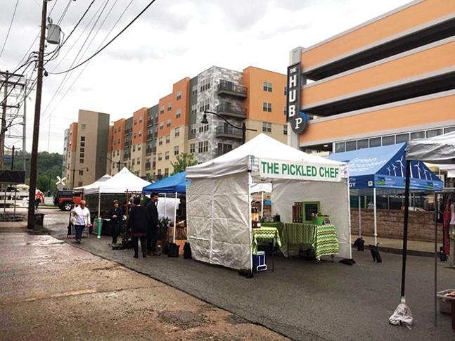 Vendors under tents at the Neighborhood Flea