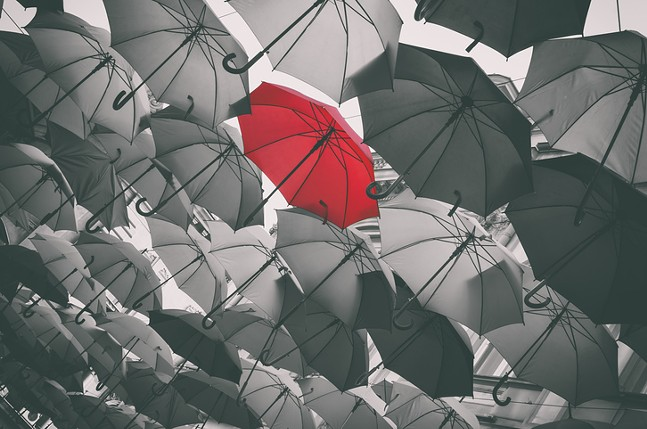 The red umbrella is a symbol reflecting the protection of those in the sex work industry.