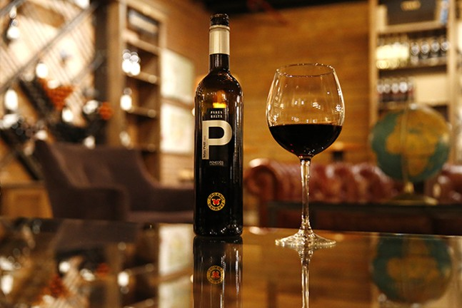 A bottle of 2015 Pares Balta Das Petit cabernet wine sits on a table near the retail wine section of The Pennsylvania Market - CP PHOTO: JARED WICKERHAM