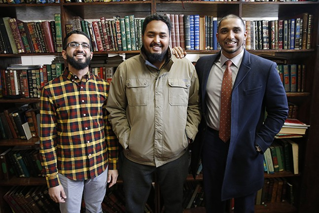 Islamic Center of Pittsburgh staff members Mohamed Sajjad and Koshin Yusuf with executive director Wasi Mohamed - CP PHOTO: JARED WICKERHAM