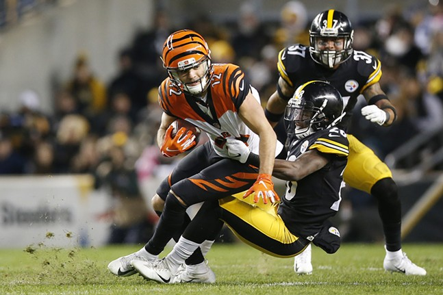 Mike Hilton #28 of the Steelers tackles Alex Erickson #12 of the Bengals. - CP PHOTO: JARED WICKERHAM