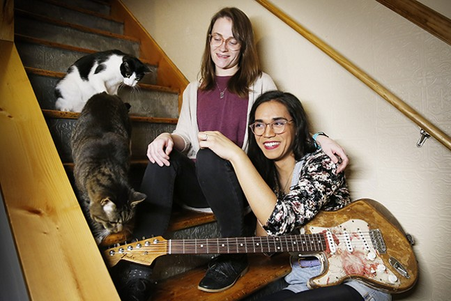 Shannon Keating and Chloe Hodgkins, members of Scratchy Blanket, pose at home with two of their cats. - CP PHOTO: JARED WICKERHAM