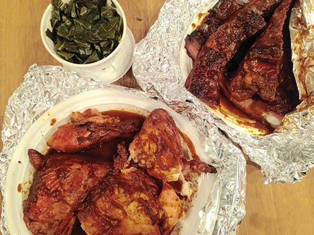 Barbecue ribs and chicken, with a side of greens, from Wilson's B-B-Q - CP PHOTO: LISA CUNNINGHAM