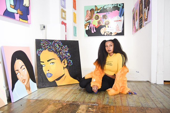 Wavy Wednesday poses with her artwork. - PHOTO: SARAH BADER