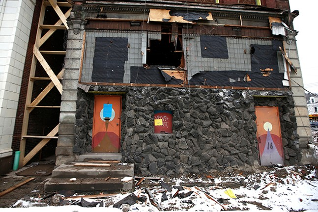 Condemned buildings are torn down next to the Garden Theater on the North Side. - CP PHOTO: JARED WICKERHAM