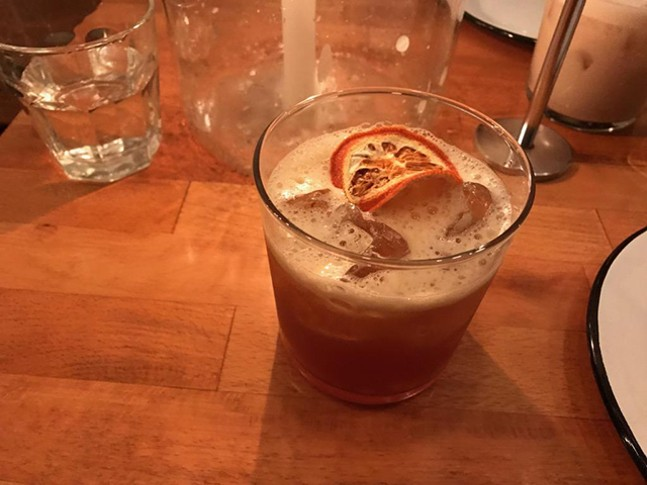 Fernet, scotch, and apple cider cocktail at Apteka - CP PHOTO: RYAN DETO