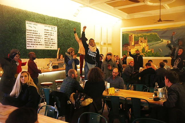 Protesters occupied Lorelei bar in East Liberty. - CP PHOTO: JARED WICKERHAM