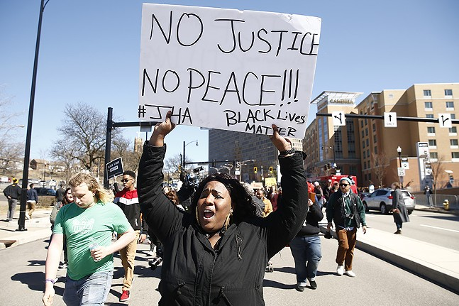 Protesters march through Downtown Pittsburgh on Sat., March 23. - CP PHOTO: JARED WICKERHAM