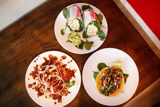 The mole poblano, veggie burrito, and chorizo burrito - CP PHOTO: JARED WICKERHAM
