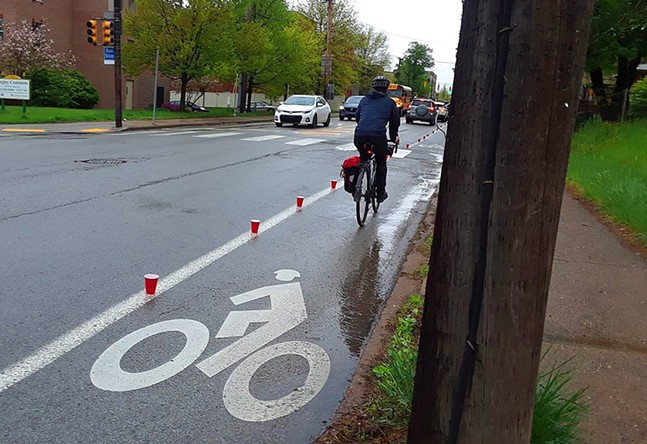 Red cups placed on Negley Avenue bike lane in East Liberty - PHOTO: BIKE PITTSBURGH