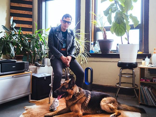 Preslav Lefterov and his dog Omar inside Machine Age Studios - CP PHOTO: JARED MURPHY