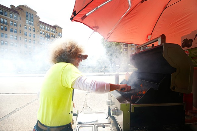 Owner John Spellman of The Shady Dog serves up hot dogs at his food cart in Shadyside. - CP PHOTOS: JARED WICKERHAM