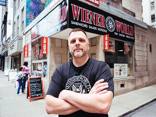Dennis Scott, owner of Wiener World, in front of his new sign - CP PHOTO: JARED MURPHY