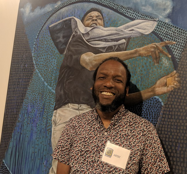 "Pittsburgh artist Ulric Joseph in front of his Best of Show winning oil painting, ""Target Practice"" - CP PHOTO: LISA CUNNINGHAM"