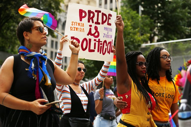 State reps Sara Innamorato and Summer Lee walk with People's Pride marchers. - CP PHOTO: JARED WICKERHAM