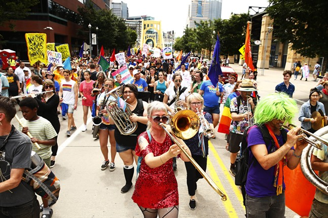 Musicians accompanied the People's Pride march as they crossed into the North Shore. - CP PHOTO: JARED WICKERHAM