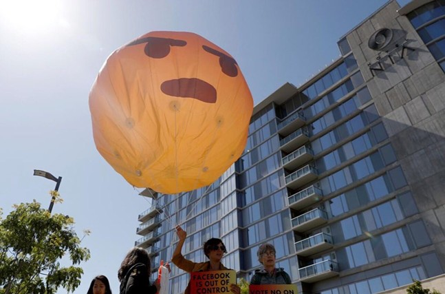 Large balloon held by Sum of Us organizers outside Facebook offices in California in May - PHOTO: ARIELLE COHEN