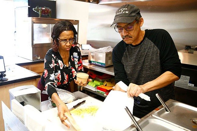 Randy and Becky Thompson prepare a to-go meal at their restaurant. - CP PHOTO: JARED WICKERHAM