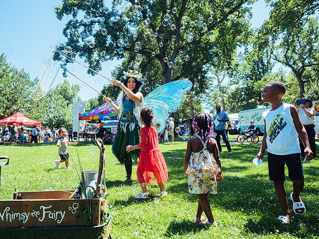 Children dance under Whimsy the Fairy's bubbles - CP PHOTO: JARED MURPHY
