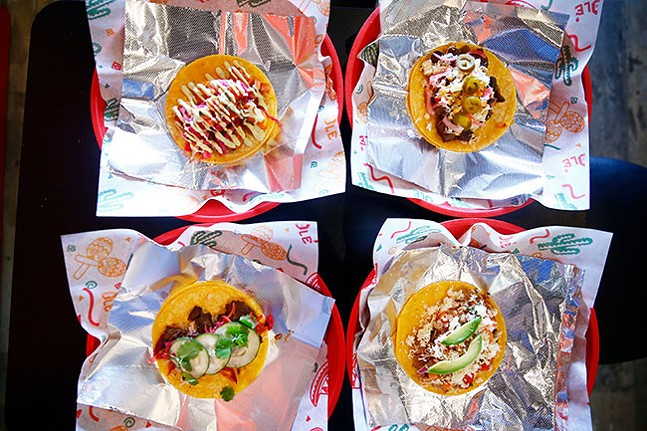 An assortment of tacos (L-R, top to bottom): Spicy shrimp, carne asada, Korean steak, and carnitas - CP PHOTO: JARED WICKERHAM