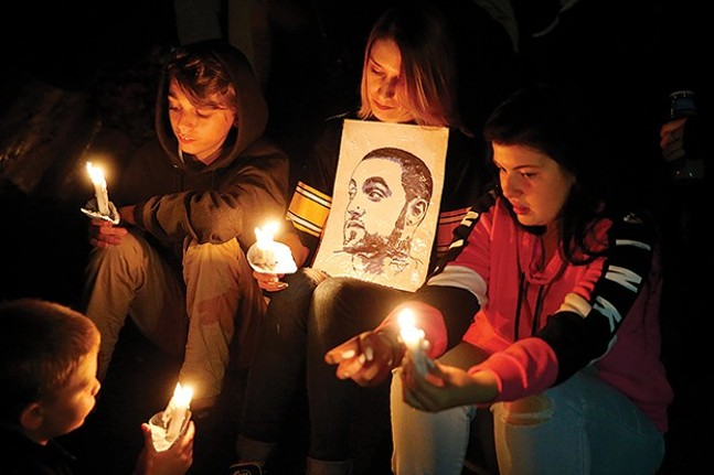 Fans mourn Mac Miller at a memorial vigil after the artist's death in September. - CP PHOTO: JARED WICKERHAM